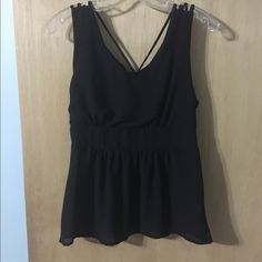 Black flowy tank This is a great black tank. It is baby doll styled so cinched in the breast. Also has strappy shoulder details & a back half zipper for easy on & off! Tops Camisoles