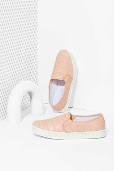 Give your sneaker collection a little love with these blush slip-ons by Report.
