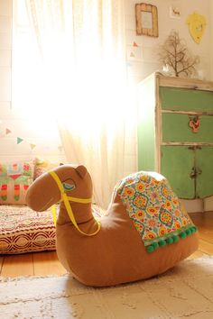 "If someone had said to me, ""Hey, would you like an oversized stuffed camel for your baby?"" I'd have laughed and assumed it was a joke. But I just saw this pin and now I have to have an oversized stuff camel for my baby."