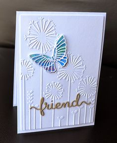 handmade card from A Little Space of My Own ... embossing and die cuts ... great embossing folder dandelion background ... luv the double die cut butterflie with pretty watercolor look behind art deco type lines ... fab card!