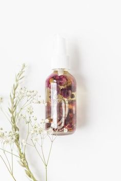 Natural, Vegan & Cruelty Free homemade beauty product from Minnesota by Miss Violet Lace. I N G R E D I E N T S: Grapeseed oil, evening primrose oil, sweet almond oil, organic rose petals, rose buds,