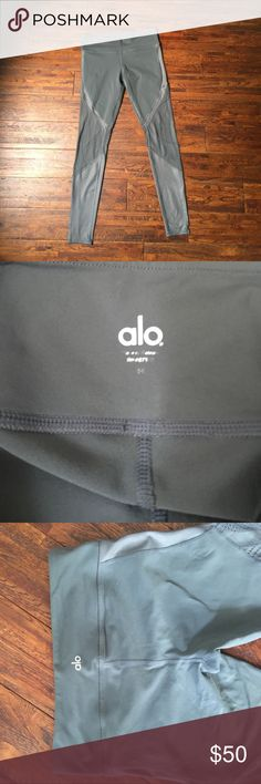 ALO Yoga leggings Lightly used alo leggings. Really love the leg detailing on these! Worn to 2 yoga practices before decided they were the wrong size for me, so signs of light wash and wear. Small stain on the front waistband (see photos), but I haven't noticed until taking photos for this listing. ALO Yoga Pants Leggings