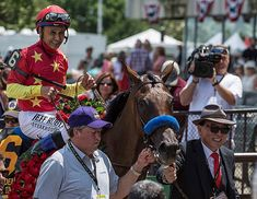 Teo Ah Khing of China Horse Club (right) leads Abel Tasman and Mike Smith into the winner's circle at Belmont Park