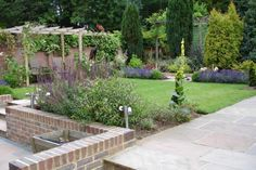 Flowing Levels in a Large Garden - ALDA Landscapes Land Drain, Sitting Area, Garden Planning, Lawn, Outdoor Living, Swimming Pools, Garden Ideas, Living Spaces, Pergola