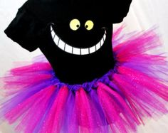 This striped purple and pink tutu is as mad as the Cheshire Cat! Its perfect for a Mad Hatter Tea Party, dressing up or even running in the Disney Disney Halloween Costumes, Cat Costumes, Scary Halloween, Halloween Party, Costumes With Tutus, Costume Ideas, Cheer Costumes, Halloween Coffin, Diy Cheshire Cat Costume