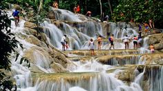 """""""Dunn's River Falls is one of Jamaica's most popular attractions. Cold, clear mountain water splashes 600 feet down on stone steps..."""""""