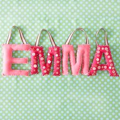 Make some stuffed letters and glue or stitch buttons onto some or all of them to add some texture and interest.