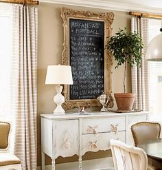 Gold framed chalkboard above the buffet...