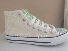 A personal favourite from my Etsy shop https://www.etsy.com/uk/listing/240371036/hand-strassed-hi-top-converse-pumps