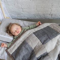 Throw blanket in grey linen shades. Hand made patchwork combination is just delightful! I think it really fits so well with a gender neutral nursery.