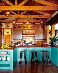Log Cabin Kitchen. i like the pop of color (not necessarily this color... maybe a barn red)