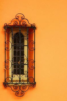 Wrought iron grille over a Spanish window.