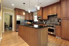 Traditional Medium Wood-Golden Kitchen Cabinets    I like the black granite countertops