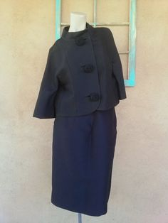Check out this item in my Etsy shop https://www.etsy.com/listing/121261523/vintage-1960s-suit-jackie-style-black
