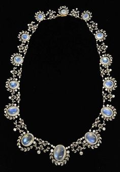 A fine Victorian diamond and moonstone necklace. The fourteen oval cabochon moonstones with diamond border linked by a garland setting. #Victorian #necklace