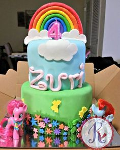 Little Pony Cake: [tier 1] vanilla cake + strawberry filling. fondant frosted. fondant flowers/butterflies/grass. [tier 2] vanilla cake + pineapple filling. fondant frosted. fondant clouds. gumpaste name/rainbow.