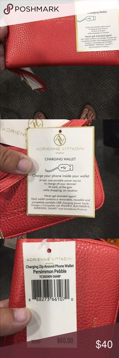 NWT Adrienne Vittadini Wallet!! This wallet contains a removable, reusable and completely portable USB charging power bank!!!! Charger is compatible with iPhone, BLACKBERRY, ANDROID, GALAXY, and Smartphone Products!! HOW COOL?! The color is a reddish orange and it has a Metallic finish. Adrienne Vittadini Bags Wallets