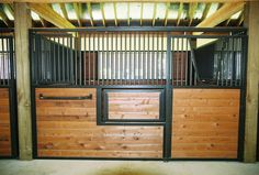 Legend 3000 Series stall system with swing out feeder! #classicequine #theresnothinglikeaclassic #besthorsestalls #barn