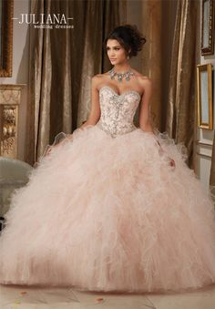 d3e849f126b Quinceanera dresses by Vizcaya Dazzling Beaded Bodice on a Ruffled Tulle  Ball Gown Matching Bolero Jacket. Available in Champagne Blush
