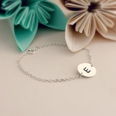 Personalised Initial Disc Bracelet This lovely delicate bracelet is a great way to wear that very special initial. The bracelet comes with one personalised 925 silver disc ready to be hand stamped with an initial of your choice. We jus http://www.MightGet.com/january-2017-13/personalised-initial-disc-bracelet.asp