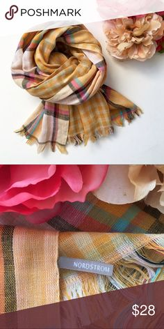 """Nordstrom Cotton Double Plaid Scarf❤️ Scarf/Wrap. 100% cotton. Light gauzy weave. Main side is the bold plaid lining is the large gingham print. Colors: tangerine,  black, fuchsia, white, pink, yellow and aqua. Frayed fringe hem at ends. Measurement: 20"""" x 75"""". This item is used in good to very good condition.❤️ Nordstrom Accessories Scarves & Wraps"""