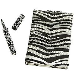 Anyone who knows me KNOWS I love all things zebra... even before animal prints were in style, I LOVED zebras.  And journals.  So naturally, a zebra journal and matching pen is HEAVEN!