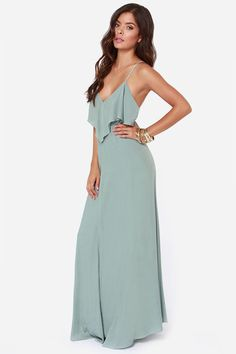 """Lulus Exclusive! Escape to serenity in the Silent Lagoon Sage Green Maxi Dress! Subtly seductive spaghetti straps support a ruffled, tiered V-neck bodice, then crisscross and tie above a V-shaped back. Woven sage fabric cascades down to a flowing maxi-length skirt. Lined in stretch knit. Model is 5'7"""" and is wearing a size small. Self: 100% Rayon. Polyester Lining. Hand Wash Cold."""