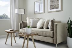 Natural wood accent tables ground the modern lines of the floor lamp and daybed, which adds an organic touch to this mellow second guest room. Revo Plan One at Novel Park for William Lyon Homes Guest Bedrooms, Guest Room, Bedroom Furniture, Bedroom Decor, Neutral, Design Awards, Floor Lamp, Modern, Table