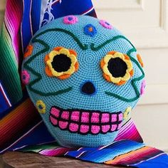 """""""This pillow was inspired by the sugar skulls of Dia de los Muertos. Click on the link in our profile for the #free #crochet pattern or search for LW4904…"""""""