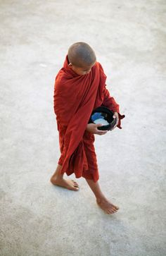 With their colorful robes and bare heads, Buddhist monks are fascinating figures in photography.