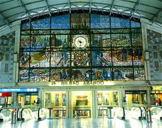 A beautiful stained-glass mural overlooks the main hall of Bilbao's Abando train station.