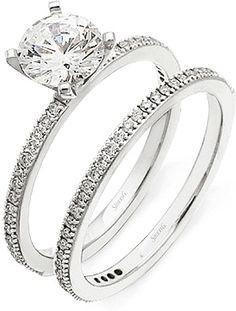 Simon G Pave Diamond Wedding band  : This diamond wedding band by Simon G features pave set round brilliant cut diamonds.