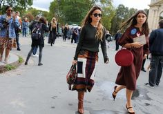 Miroslava Duma in Gabriela Hearst top, skirt, boots and a Maison Margiela bag, and Katya Darma with a Mansur Gavriel bag
