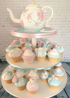 Pretty pastels used to create an elegant display with a teapot cake and coordinating cupcakes, all edible. Tea Party Baby Shower, Baby Shower Cupcakes, Shower Cakes, Themed Cupcakes, Birthday Cupcakes, Cake And Cupcake Stand, Cupcake Cakes, Beautiful Cakes, Amazing Cakes