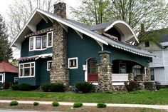 dark green + round stone piers on craftsman style bungalow porch. Love the looks of this house! Craftsman Style Bungalow, Bungalow Homes, Craftsman Bungalows, Bungalow Porch, Craftsman Homes, House Paint Exterior, Exterior House Colors, Exterior Design, Craftsman Exterior Colors