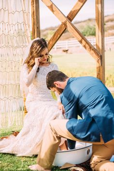 13 Symbolic Tradition Ideas for your Wedding Ceremony: groom washing the feet of his emotional bride as a sign of purification