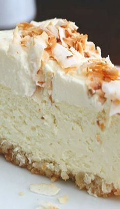 Coconut cheesecake with macadamia nut crust. Sub honey for Swerve