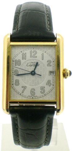 "Vintage Cartier Men's tank watch. Promise to casually toss it on every day and practice saying, ""Oh this old thing?""."