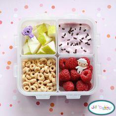 Here was a cute little morning nutrition break bento box. She got a container of sliced pears with a cute pick, a container of raspberries with a cute pick, a container of plain cheerios, and a container of yogurt with sprinkles.
