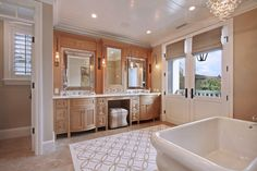 brown wooden cabinet with cream marble top with two sinks in the left and right with makeup counter in the middle