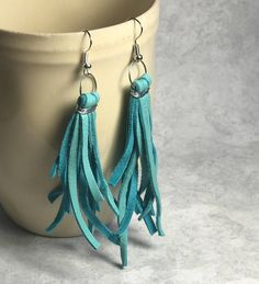 Leather teal tassel earrings