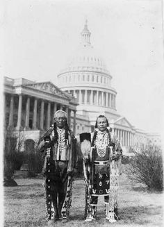 Native American chiefs Frank Seelatse and Jimmy Noah Saluskin of the Yakama tribe pose with the U.S. Capitol behind them in 1927.