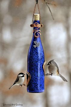DIY Wine Bottle Bird Feeder...http://homestead-and-survival.com/diy-wine-bottle-bird-feeder/