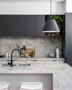 Want to say goodbye to grout lines in your splashback? We thought so! There's nothing quite as luxurious as a solid stone splashback to give your kitchen instant wow factor. With the added benefit that it's easy to wipe clean, the stone splashback gets our vote and has us crushing hard. As with any natural stone product, regular sealing is the best way to keep your splashback looking oh so fine. Follow us on Instagram and Pinterest for more design tips and inspo. Design by Chamberlain…