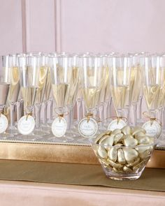 Your guests will be more than happy to find their seating assignments when their cards come with a glass of bubbly. Just tie your escort cards around Champagne flutes and--voila!--you're ready for a toast.Champagne flutes, MarthaCelebrations (available at jcpenney.com).