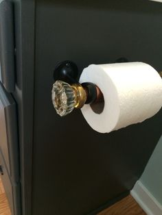 Toilet paper holder by Tina Interval Delaney,made from vintage glass doorknobs. I used curtain rod holders and copper tubing to make this.