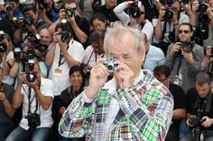 Bill Murray at Cannes film festival with Minox Leica miniature digital camera