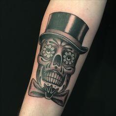 Sugar skull tattoo by Nate Fierro
