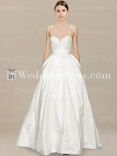 Informal beach wedding dress is crafted in Taffeta. Features include a fitted bodice with lace appliques, spaghetti straps and illusion back.