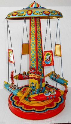 VINTAGE J.CHEIN ROCKET RIDE LARGE CARNIVAL AMUSEMENT PARK TIN WIND UP TOY 1950's. How beautiful!